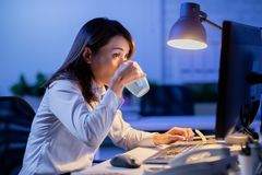 Woman overtime work royalty free stock images