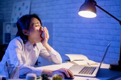 Woman overtime work stock image