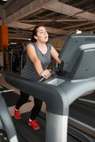 Hard work at the gym with overweight stock photography