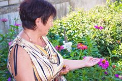 The woman with own to a garden Stock Images