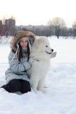 Woman owner hugging white Samoyed dog Stock Photography
