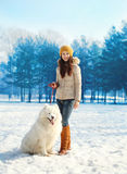 Woman owner walking with white Samoyed dog in winter Royalty Free Stock Image