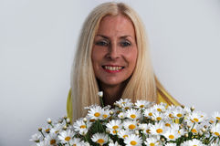 Woman with oxeye daisy Stock Photo