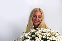 Woman with oxeye daisy Royalty Free Stock Image