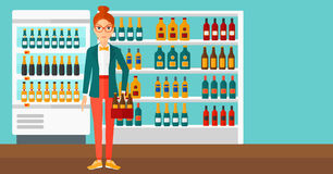 Woman with pack of beer. A woman standing in the supermarket and holding a pack of beer vector flat design illustration. Horizontal layout Stock Photography