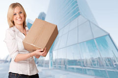 Woman with package downtown Royalty Free Stock Photo