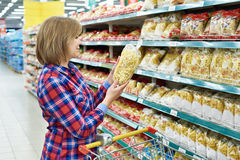 Woman with package pasta in shop Royalty Free Stock Photography