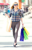 Woman with packages after shopping in the city Royalty Free Stock Photography