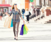 Woman with packages after shopping in the city Stock Photo