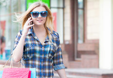 Woman with packages after shopping in the city Royalty Free Stock Photo