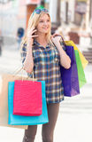 Woman with packages after shopping in the city Royalty Free Stock Images