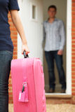 Woman With Packed Suitcase Leaving Husband. Woman With Packed Suitcase Leaves Husband Royalty Free Stock Photo