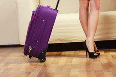 Woman with packed suitcase Stock Photo