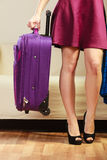 Woman with packed suitcase Stock Photography