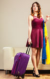 Woman with packed suitcase Stock Images