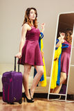 Woman with packed suitcase Stock Photos