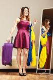 Woman with packed suitcase Royalty Free Stock Image