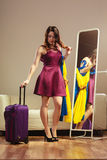 Woman with packed suitcase Royalty Free Stock Photography