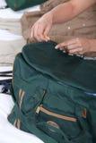 Woman packing bag Royalty Free Stock Image