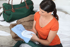 Woman packing a bag Royalty Free Stock Image
