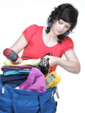 Woman packing bags Royalty Free Stock Images