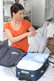 Woman packing bags Stock Images