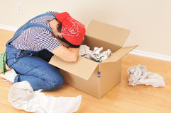 Woman and Packing Box Royalty Free Stock Photos