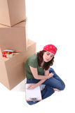 Woman and packing boxes Royalty Free Stock Photography
