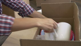 Woman Packing Boxes Ready For House Move stock video