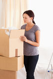 Woman packing a cardboard Royalty Free Stock Photography