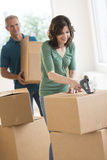 Woman Packing Cardboard Box At Home Royalty Free Stock Images