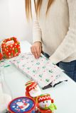 Woman Packing Christmas Gifts Stock Photography