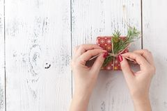 Woman is packing Christmas gifts. Red christmas gift boxes. Stock Images