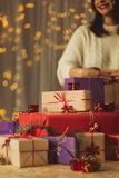Woman packing christmas presents Royalty Free Stock Image
