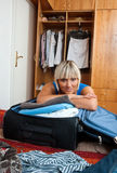 Woman packing clothes Stock Photos
