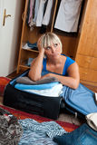 Woman packing clothes Royalty Free Stock Images