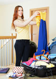 Woman packing dress for vacation Stock Photo