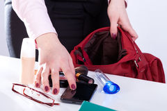 Woman packing handbag Royalty Free Stock Photo