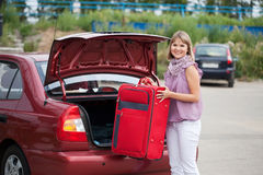 Woman packing her baggage Stock Photo