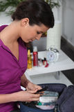 Woman packing her toiletries Royalty Free Stock Photos