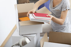 Woman packing herself Royalty Free Stock Image