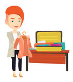 Woman packing his suitcase vector illustration. Stock Photo