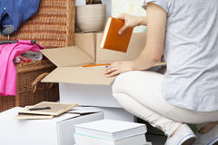 Woman Packing House Stuff Royalty Free Stock Images