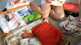 Woman packing a luggage for a new journey stock video