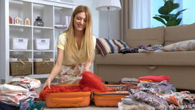Woman packing a luggage for a new journey stock footage
