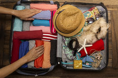 Woman packing a luggage for a new journey. Travel concept Stock Images