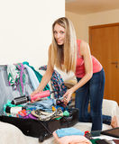 Woman packing a suitcase Stock Photos