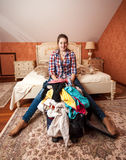 Woman packing suitcase for vacation in bedroom Royalty Free Stock Photos