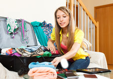Woman is packing a suitcase Royalty Free Stock Images
