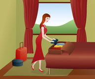 Woman packing suitcases Stock Photo